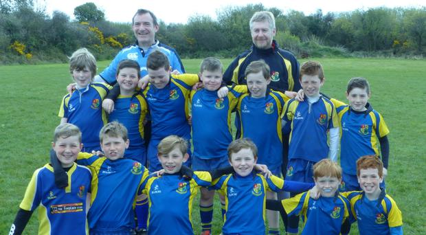 Carrigaline's U-12 team with coaches Eugene and Garry