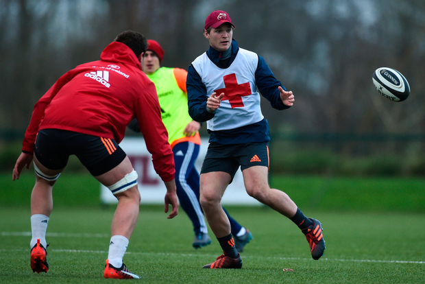 Tyler Bleyendaal keeps his eyes on the ball during Munster training