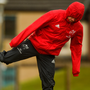 Munster's Keith Earls wraps up well against the elements during training in Limerick. Photo: Sportsfile