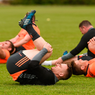 Rory Scannell and CJ Stander going through their stretching routine
