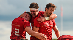 Billy Holland (centre) congratulates Rory Scannell (left), with Darren Sweetnam, on scoring his side's first try against Cheetahs. Picture: Sportsfile
