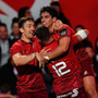 Joey Carbery celebrates scoring his side's second try last weekend with Darren Sweetnam and Dan Goggin. Photo: SPORTSFILE