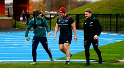 Back in the groove: Ian Keatley, Jeremy Loughman and Chris Cloete share a joke on the way to training. Photo: SPORTSFILE