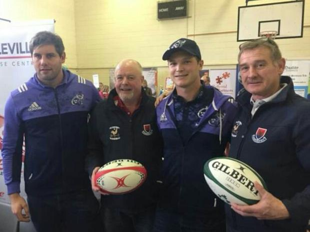 Munster's Dave O'Callaghan (left) and Tyler Bleyendaal alongside Charleville and district club p resident Pa Leahy (left) and Chairman Maurice Bridgeman