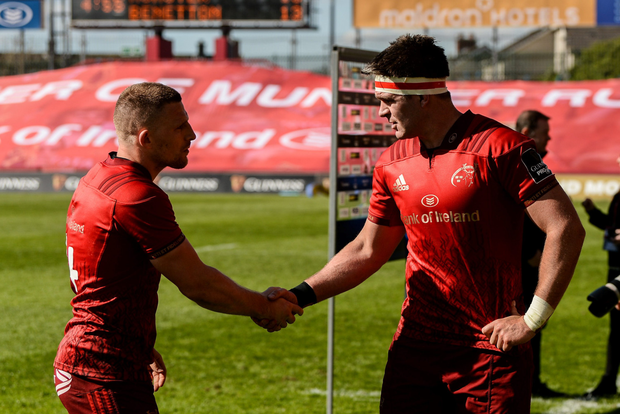 Andrew Conway congratulates Billy Holland after the Benetton win. Photo: Sportsfile