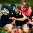 Shane Daly is tackled by team-mate Liam Coombes during a squad training session