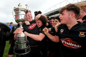 Newcastle West-Estuary's Dylan Murphy with the trophy