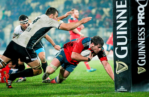 Munster's Dave O'Callaghan attempts to score a try in Guinness PRO12. Health Minister Leo Varadkar said there is concern that banning sponsorship by alcohol firms would cause funding difficulties for sporting organisations.