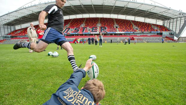 Michael Madden takes part in the Father's Day Penalty Kick Competition to celebrate the Rugby World Cup Trophy Tour which stopped by in Thomond Park, Limerick