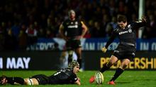 Saracens player Alex Goode kicks a penalty as Kelly Brown looks on during an Aviva Premiership match between Gloucester Rugby and Saracens