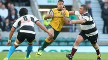 Israel Folau of Australia is tackled by Matt Stevens and Steven Luatua (L) during the Killick Cup match between the Barbarians and Australian Wallabies at Twickenham Stadium