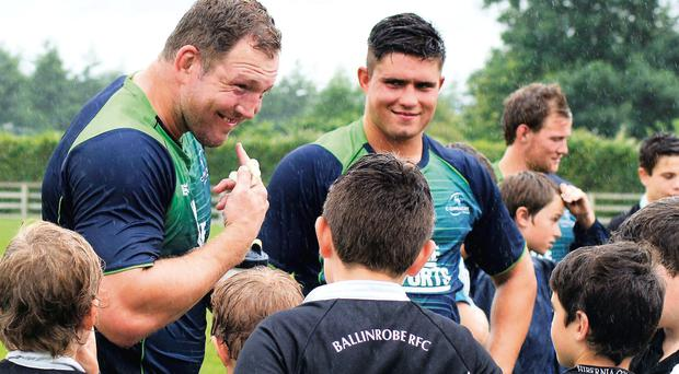 Connacht's Michael Swift and Dave Heffernan chat with young players during Connacht's visit to Ballinrobe.
