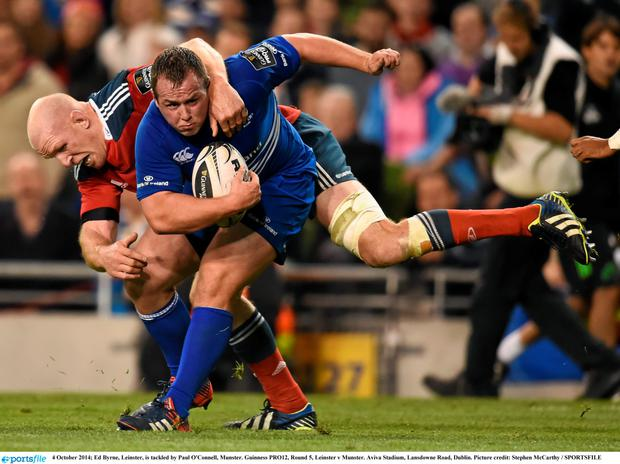 Leinster's Ed Byrne is tackled by Paul O'Connell of Munster during their Pro 12 encounter last October. Photo: Stephen McCarthy / SPORTSFILE