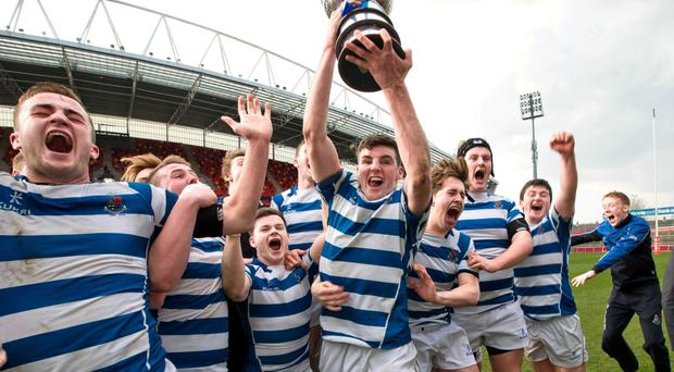 Winning Rockwell captain Seán O'Connor lifts the 2015 SEAT Munster Schools Senior Cup