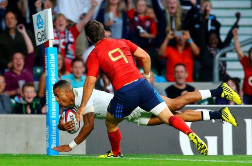 France's Morgan Parra can't prevent Anthony Watson from scoring England's first try at Twickenham last night