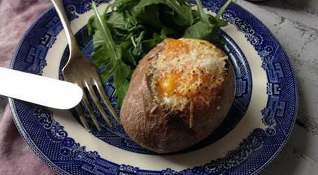 Baked potato with eggs