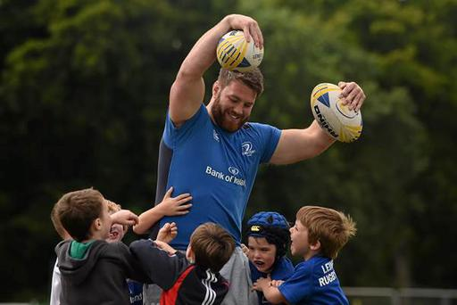 Sean O'Brien with children on a Bank of Ireland Leinster rugby camp. Photo:
