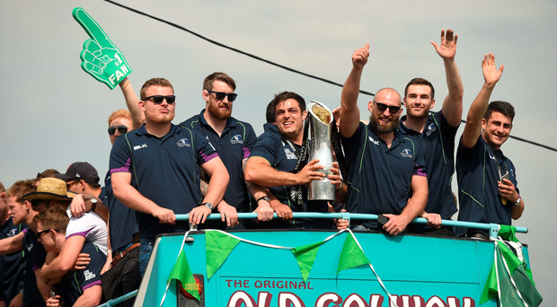 Finlay Bealham, Aly Muldowney, Ronan Loughney, John Muldoon, Andrew Browne and Tiernan O'Halloran celebrate on the team bus last Sunday. Photo: Diarmuid Greene