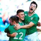 Shane Daly, second from left, of Ireland celebrates with his Ireland U-20 team-mates after scoring a late try against Argentina. Photo: Sportsfile