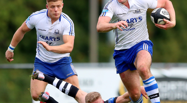 Old Belvedere's Steve Crosbie tries to stop Cork Con's Niall Kenneally in the Ulster Bank League game Photo: NPHO/James Crombie