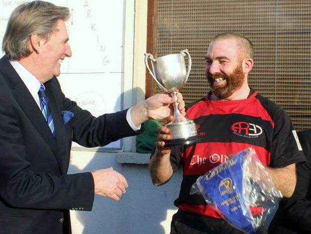 Arklow Captain Barry Clear receiving the Division Three trophy last season.