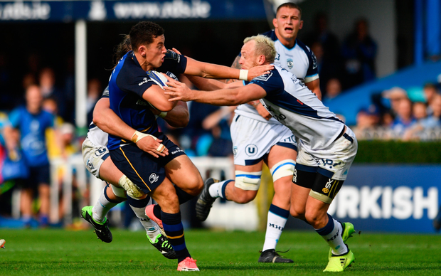 Noel Reid holds off Jesse Mogg's challenge during Leinster's victory over Montpellier. Photo: Ramsey Cardy/Sportsfile