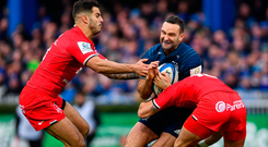 Dave Kearney being tackled by Toulouse's Sofiane Guitoune and Romain Ntamack. Photo: Stephen McCarthy/Sportsfile