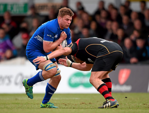 Jordi Murphy, Leinster, is tackled by Brok Harris, Newport Gwent Dragons