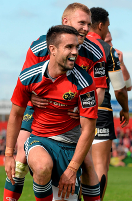 Conor Murray is congratulated by team-mate Keith Earls after scoring his third try at Irish Independent Park