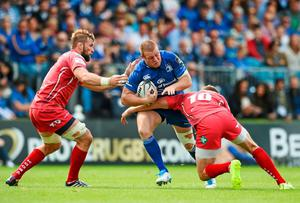Sean Cronin, Leinster, is tackled by John Barclay, left, and Rhys Priestland, Scarlets