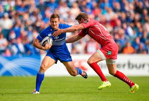 Jimmy Gopperth, Leinster, is tackled by Rhys Priestland, Scarlets