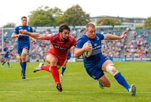 Sean Cronin, Leinster, goes over for a try, which was subsequently disallowed, despite the tackle of Gareth Owen, Scarlets