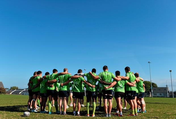 The Connacht squad gather in a huddle during squad training ahead of tomorrow's match against Glasgow Warriors