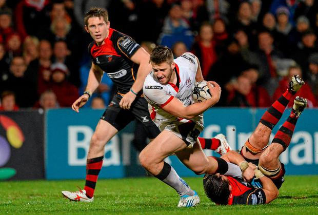 Stuart McCloskey, Ulster, is tackled by James Benjamin, Newport Gwent Dragons