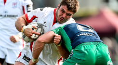 Wiehahn Herbst, Ulster, is tackled by John Muldoon, Connacht