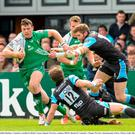 Robbie Henshaw evades a tackle against Glasgow