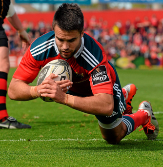 Munster scrumhalf Conor Murray scores his third try in his side's bonus point victory over Newport Gwent Dragons at Irish Independent Park yesterday. Photo: Diarmuid Greene
