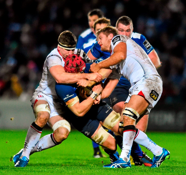 Josh van der Flier, Leinster, is tackled by Robbie Diack, left, and Chris Henry, Ulster