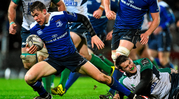 Leinster's Garry Ringrose is tackled by Connacht's Jake Heenan on a squally night at the RDS Photo:Sportsfile