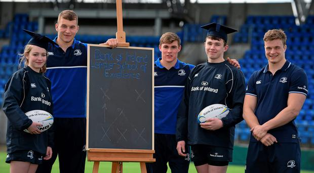 Leinster Rugby stars, from left, Ross Molony, Garry Ringrose, Josh van der Flier are joined by Caoimhe Power (16) of Navan RFC and Sean Dunne (16), second from right, of Lansdowne FC at Donnybrook Stadium to mark the launch of the Bank of Ireland Leinster Rugby School of Excellence which will run in The King's Hospital School, Palmerstown in July and August