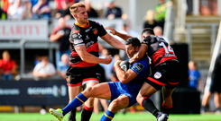 Rob Kearney being tackled by Dragons' Ashton Hewitt during their opening PRO14 match. Photo: Sportfile