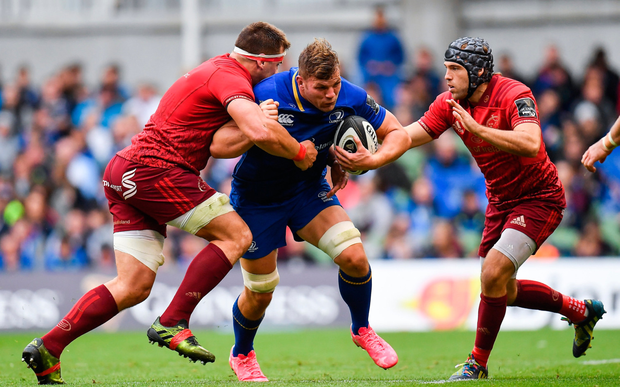 Jordi Murphy battling Munster's CJ Stander and Duncan Williams. Photo: RAMSEY CARDY/SPORTSFILE