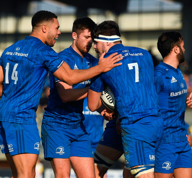Leinster's Max Deegan, 7, celebrates with team-mates after scoring his side's first try. Photo by Ramsey Cardy/Sportsfile