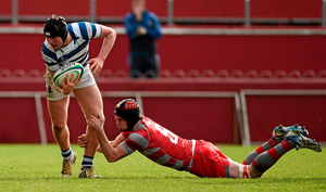 Ben Murray, Rockwell College, is tackled by Ben Clancy, Glenstal Abbey