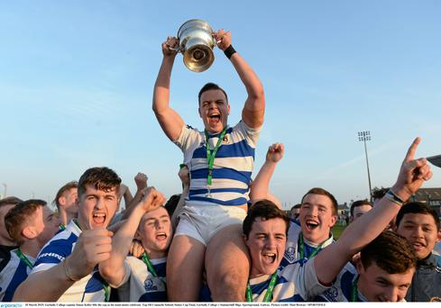 Garbally College captain Simon Keller lifts the cup as his team-mates celebrate their Connacht Schools Senior Cup final victory over Garbally College
