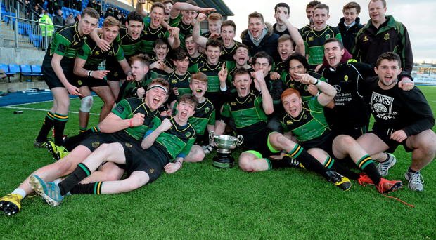 St Conleth's captain Kevin Dolan celebrates with his team-mates after their McMullen Cup victory at Donnybrook this week