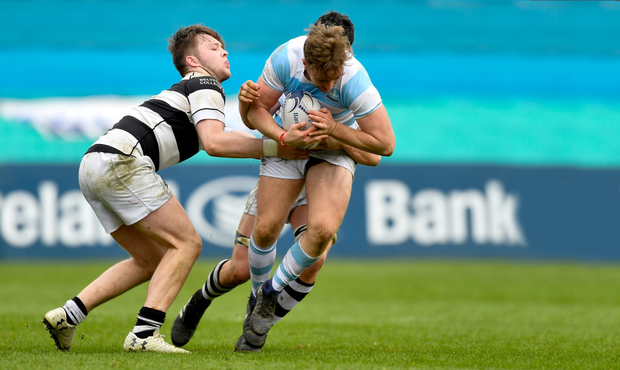 Liam Turner of Blackrock College in action against Ruadhan Byron, left, and Aaron Coleman of Belvedere College during last year's Leinster Schools Senior Cup final. Photo by Piaras Ó Mídheach/Sportsfile