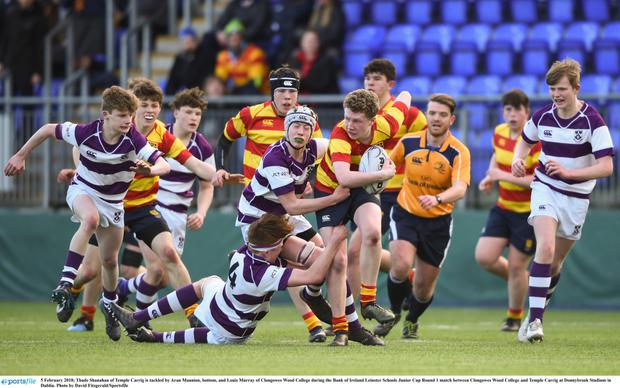Thade Shanahan of Temple Carrig is tackled by Aran Mannion and Louis Murray of Clongowes during last year's Junior Cup Round 1 game