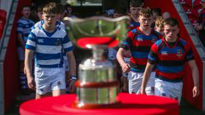 FOCUSED: St Munchin's and Rockwell make their way onto the pitch for last year's Munster Junior final Photo by Oisin Keniry/INPHO