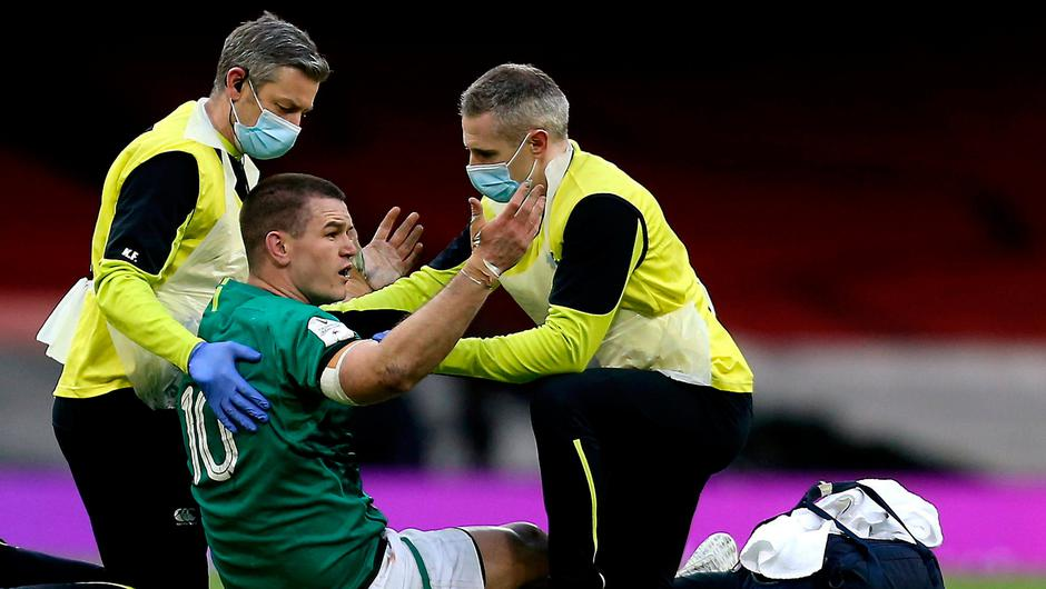 Ireland captain Johnny Sexton being treated on the pitch against Wales.